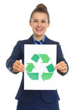 Business woman showing paper sheet with recycle sign Royalty Free Stock Photography