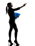 Business woman showing pointing  holding folders files silhouett Royalty Free Stock Image