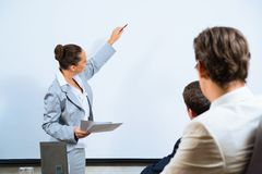 Business woman showing a presentation Stock Images