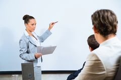 Business woman showing a presentation Royalty Free Stock Photos