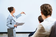 Business woman showing a presentation Stock Photos