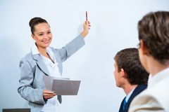 Business woman showing a presentation Stock Image