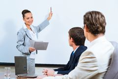 Business woman showing a presentation Royalty Free Stock Photo