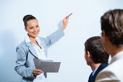 Business woman showing a presentation Royalty Free Stock Photography