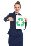 Business woman showing recycle sign and pointing in camera Royalty Free Stock Photos