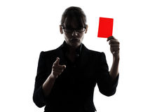 Business woman showing red card silhouette. One business woman showing red card  silhouette studio isolated on white background Royalty Free Stock Photography