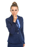 Business woman showing shh gesture Royalty Free Stock Images