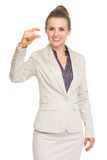 Business woman showing small risk gesture Stock Photography