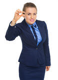 Business woman showing small risks gesture Royalty Free Stock Photos