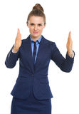 Business woman showing something big Stock Photography
