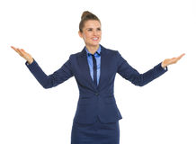 Business woman showing something big Stock Photo