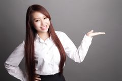 Business woman showing something Stock Image