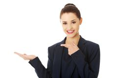 Business woman showing something or copyspase Stock Image
