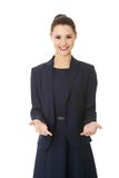 Business woman showing something or copyspase Stock Images