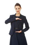 Business woman showing something or copyspase Royalty Free Stock Images