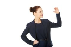 Business woman showing something or copyspase Royalty Free Stock Photos
