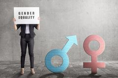 Business woman showing symbol of gender equality in the white banner. Equality gender concept stock images