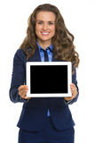 Business woman showing tablet pc blank screen Stock Image