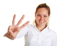 Business woman showing three Royalty Free Stock Image