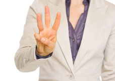 Business woman showing three with fingers Royalty Free Stock Photo
