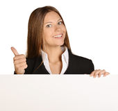 Business woman showing thumb up and holding a Stock Photo