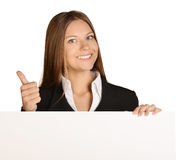 Business woman showing thumb up and holding a Royalty Free Stock Photos