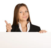 Business woman showing thumb up and holding a Stock Photos