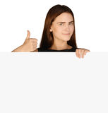 Business woman showing thumb up and holding a Royalty Free Stock Photography
