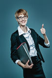 Business woman showing thumb up and holding a folder with documents Royalty Free Stock Images
