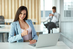Business Woman Showing thumbs up Gesture. Business People Stock Photo