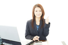 Business woman showing thumbs up sign Royalty Free Stock Image