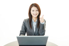 Business woman showing thumbs up sign Stock Image