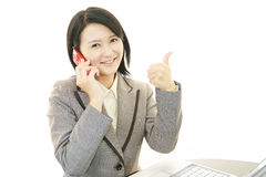 Business woman showing thumbs up sign Stock Photo