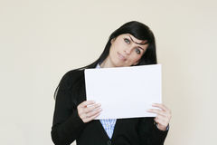 Business woman showing to the camera a white paper Royalty Free Stock Photography