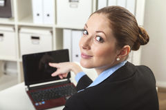 Business woman showing to laptop Royalty Free Stock Image