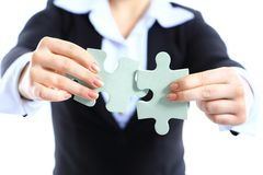 Business woman showing two jigsaw puzzle pieces Stock Images