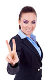 Business woman showing victory sign. Bright picture of lovely business woman showing victory sign Stock Images
