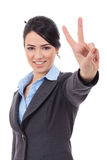 Business woman showing victory sign. Picture of lovely business woman showing victory sign Stock Photos