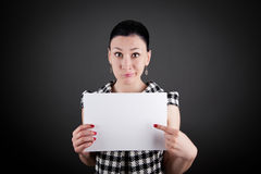 A business woman showing a white board Royalty Free Stock Photo