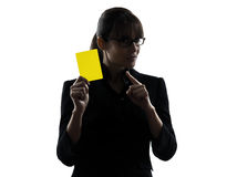 Business woman showing yellow card silhouette. One business woman showing yellow card  silhouette studio isolated on white background Royalty Free Stock Photo