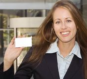 Business Woman - Showing you a business card. A business woman is showing you her black business card stock photos