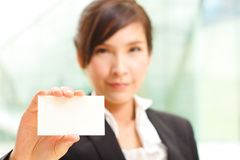 Business woman shows business card Stock Photography