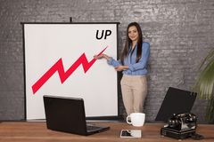 Business woman shows company profits stock photography