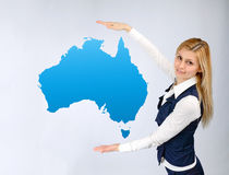 Business woman shows the continent of Australia Stock Photography
