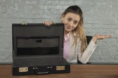 business woman shows that she did not get a bribe in the briefcase royalty free stock photos