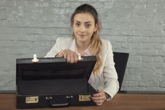 Business woman shows empty briefcase stock image