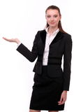 Business woman shows empty hand. Royalty Free Stock Photography