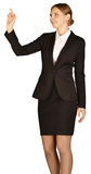 Business woman shows forefinger up. white. Background stock photo