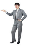 Business Woman Shows With Her Hand Aside Royalty Free Stock Photography