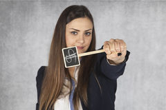 Business woman shows a symbol of the dollar as a powerful curren Stock Image